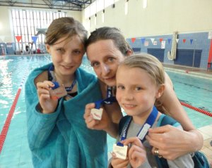 us 3 girls with medals