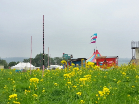 Glastonbury  set up: flowers and tents