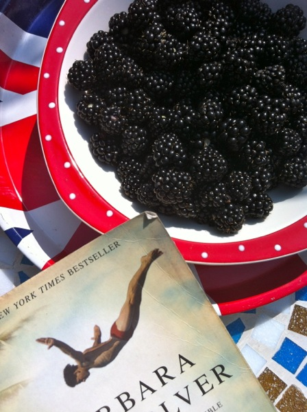 bowl of blackberries and a book