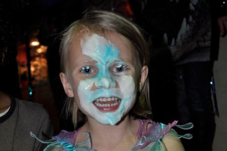 Girl with face smeared in cream