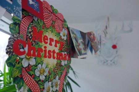 String of Christmas cards and merry christmas sign