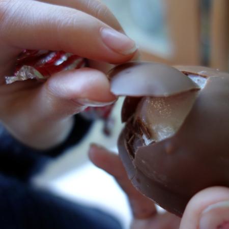 peeling chocolate off teacake